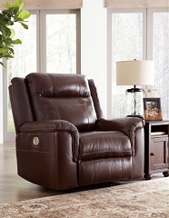 WYLINE COFFEE LEATHER MATCH POWER RECLINER CHAIR WITH ADJUSTABLE HEADREST BY ASHLEY